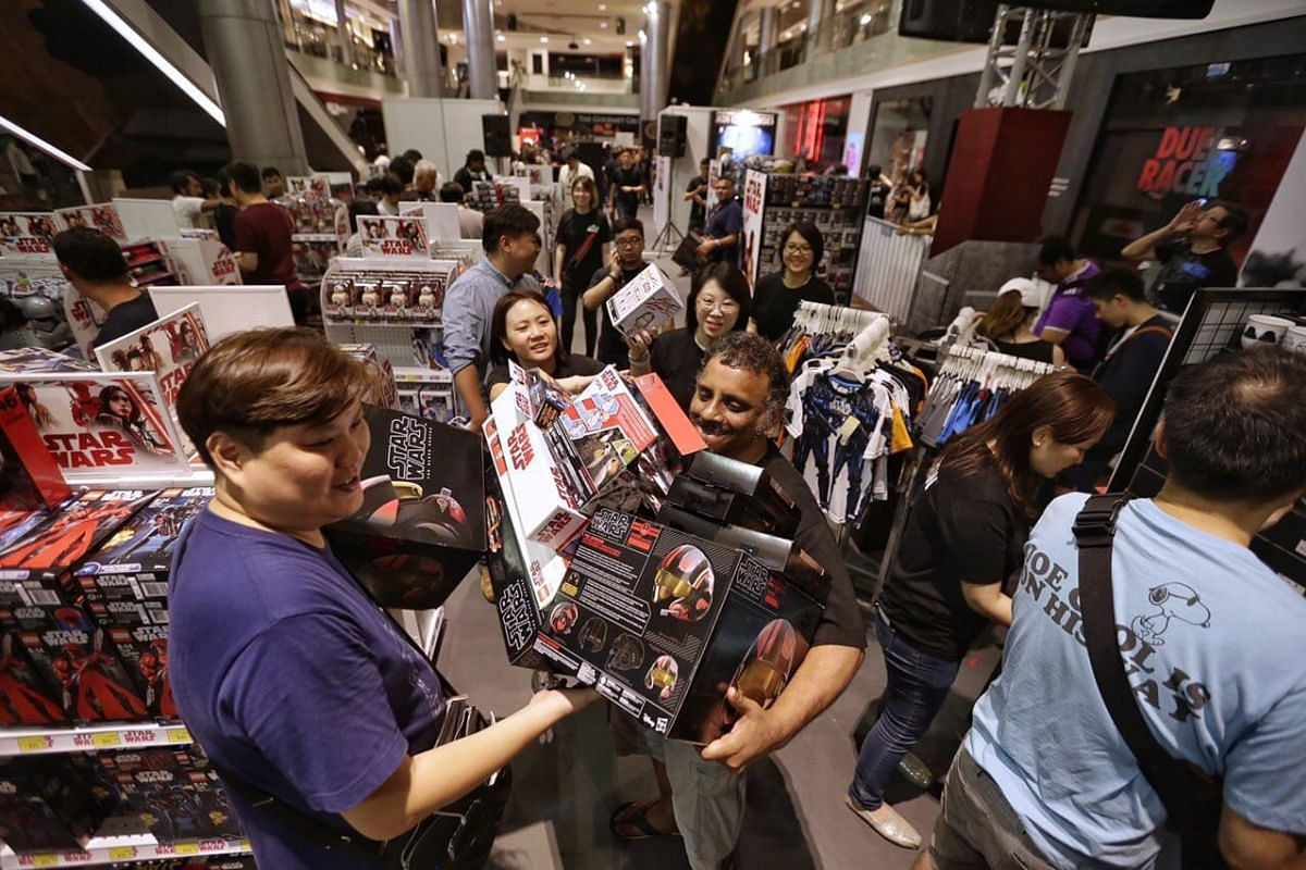 Sreedharan s/o G Radhakrishnan attempts to lug all the merchandise to the cashier  at ION Orchard on Sept 1.