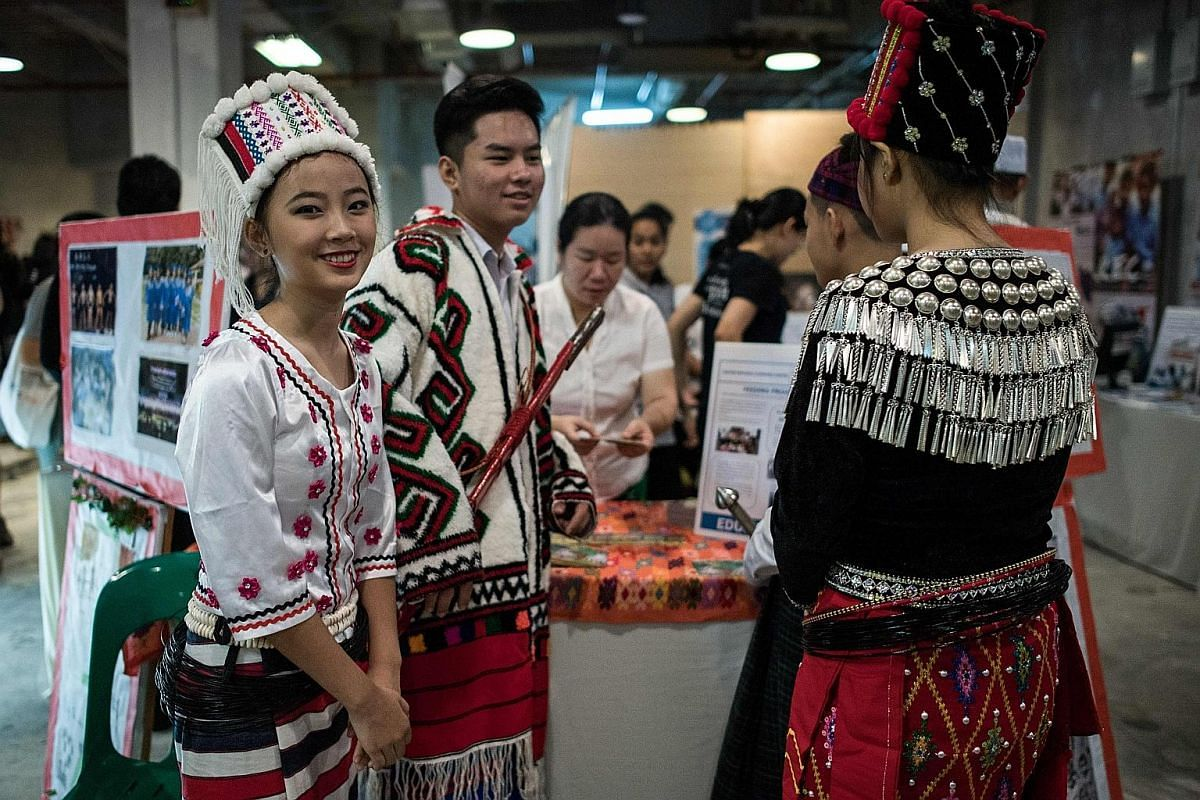 Left: Myanmar refugees in traditional dress. There are some 150,600 refugees in Malaysia. They are recognised as asylum seekers, but are not allowed to work, drive, open bank accounts or go to school.