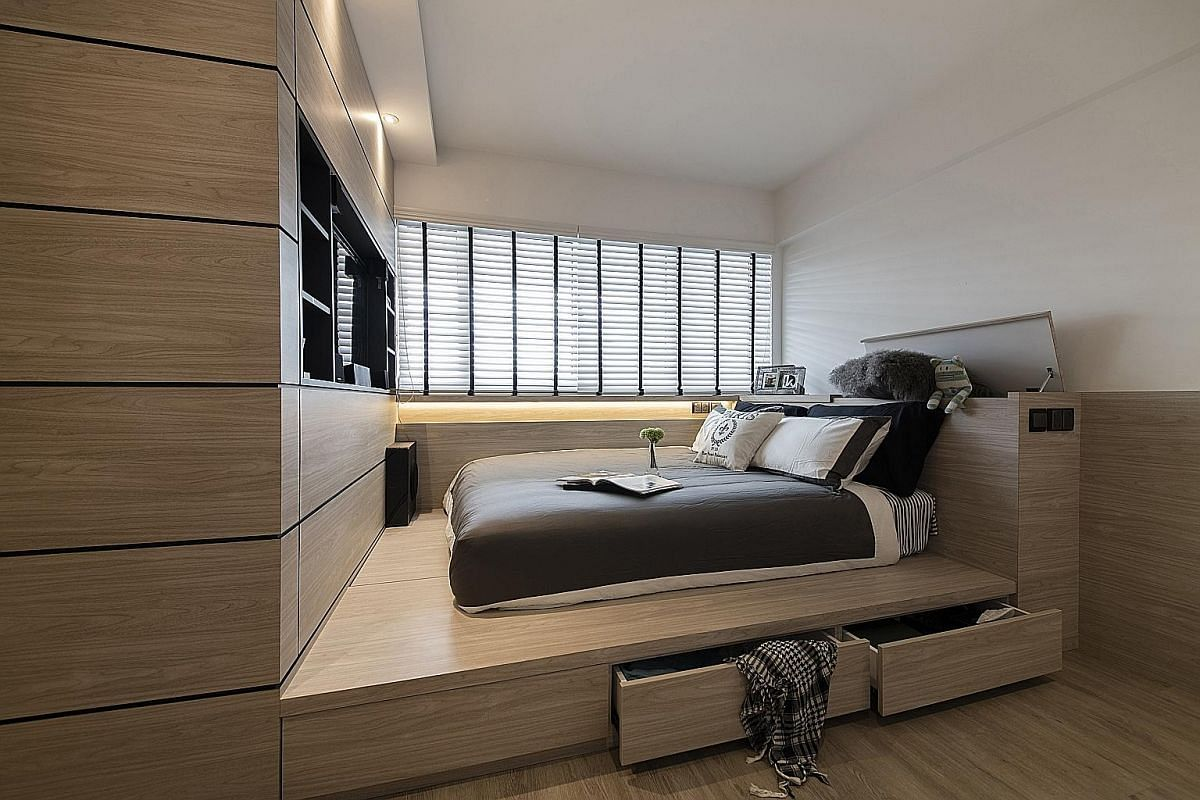 Floor to ceiling shelves or beds with storage beneath them help to maximise storage