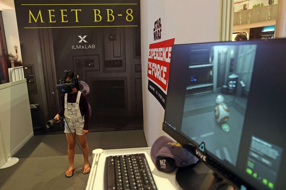 Lyn Cheng, 7, tries a BB-8 VR game on Sept 1, 2017, the first day of 10-day Star Wars festival at Ion Orchard shopping mall.