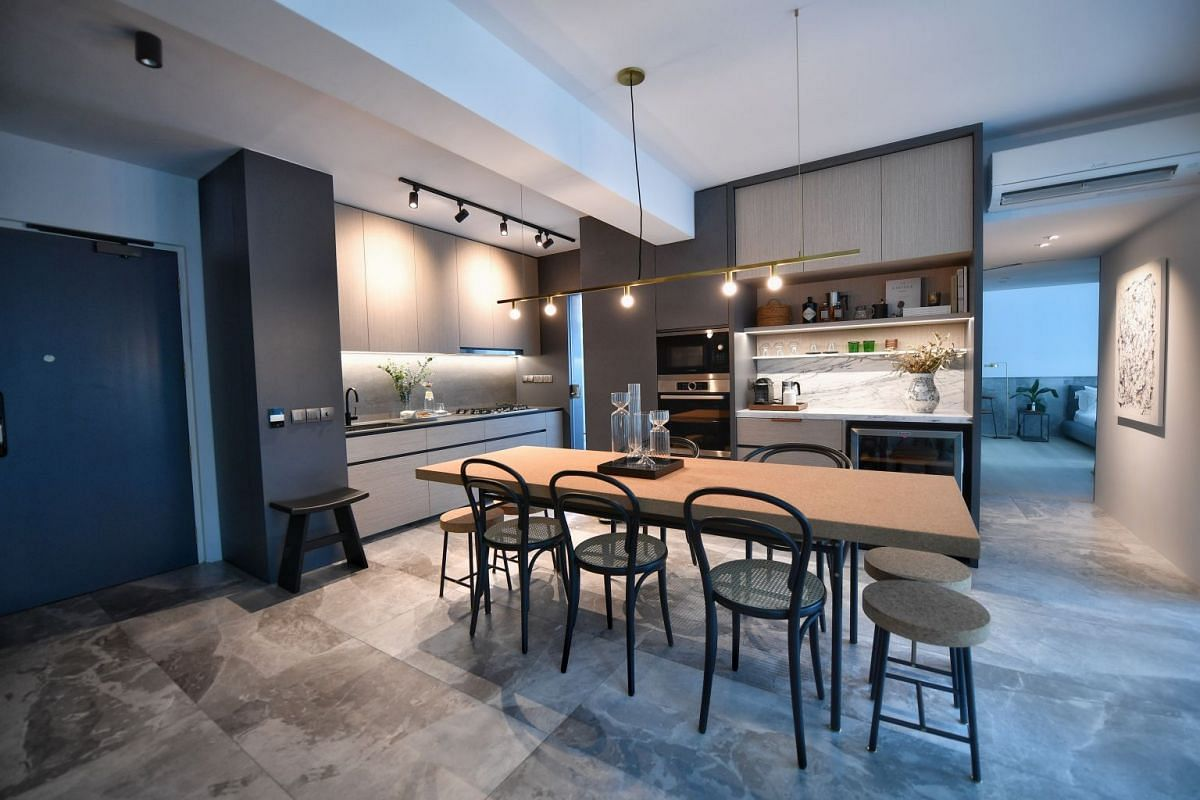 Interior designer and home owner Vanessa Ong knocked down some of the walls in the kitchen and replaced the brick wall of one room with a sliding door to let natural light in.