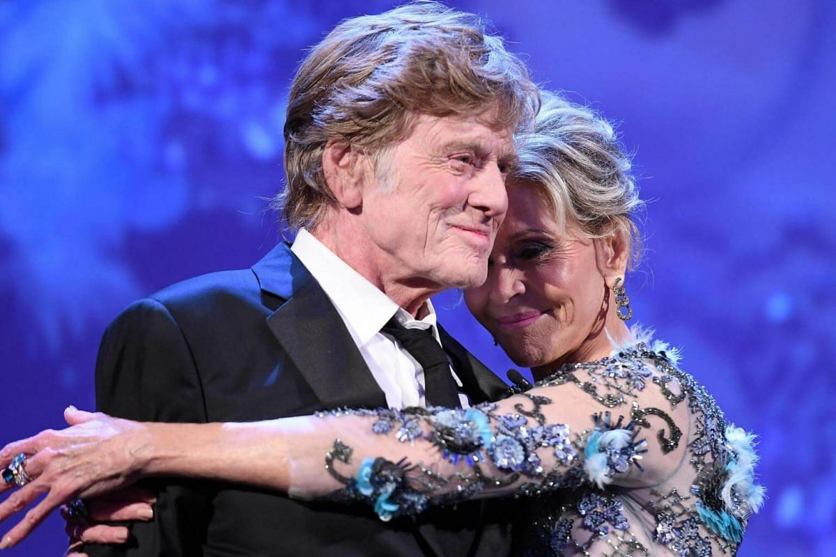 US actors Robert Redford and Jane Fonda embracing on stage after receiving their Lifetime Achievement Awards at the Venice Film Festival on Sept 1, 2017.