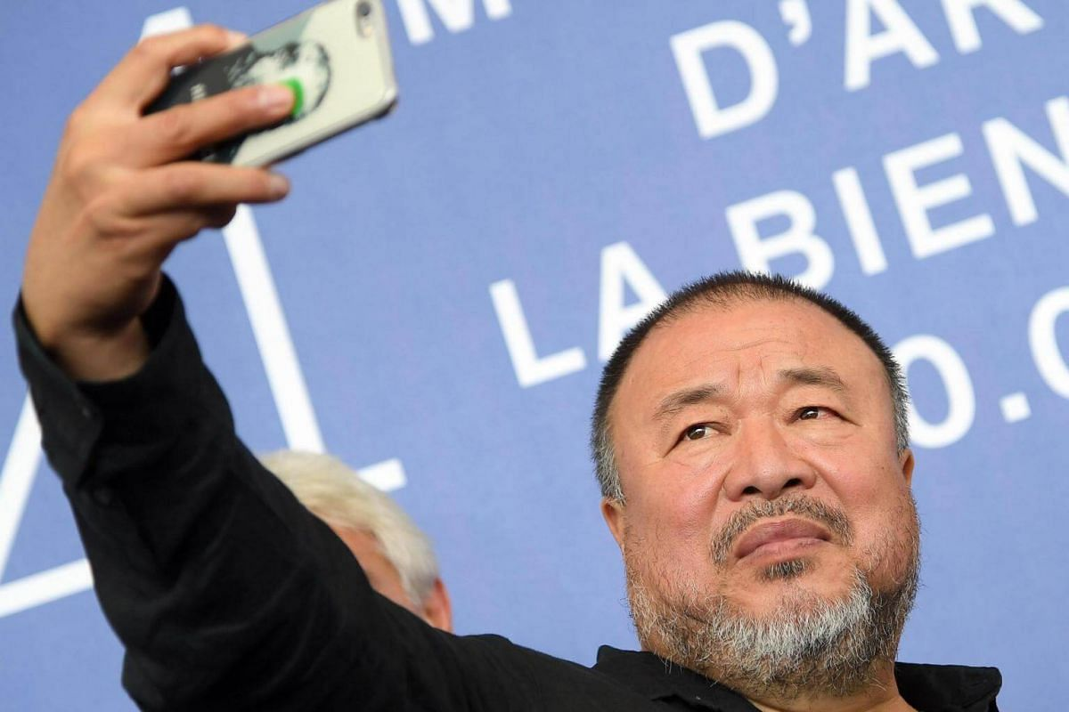 Chinese artist and film director Ai Weiwei taking a selfie at the Venice Film Festival on Sept 1, 2017.