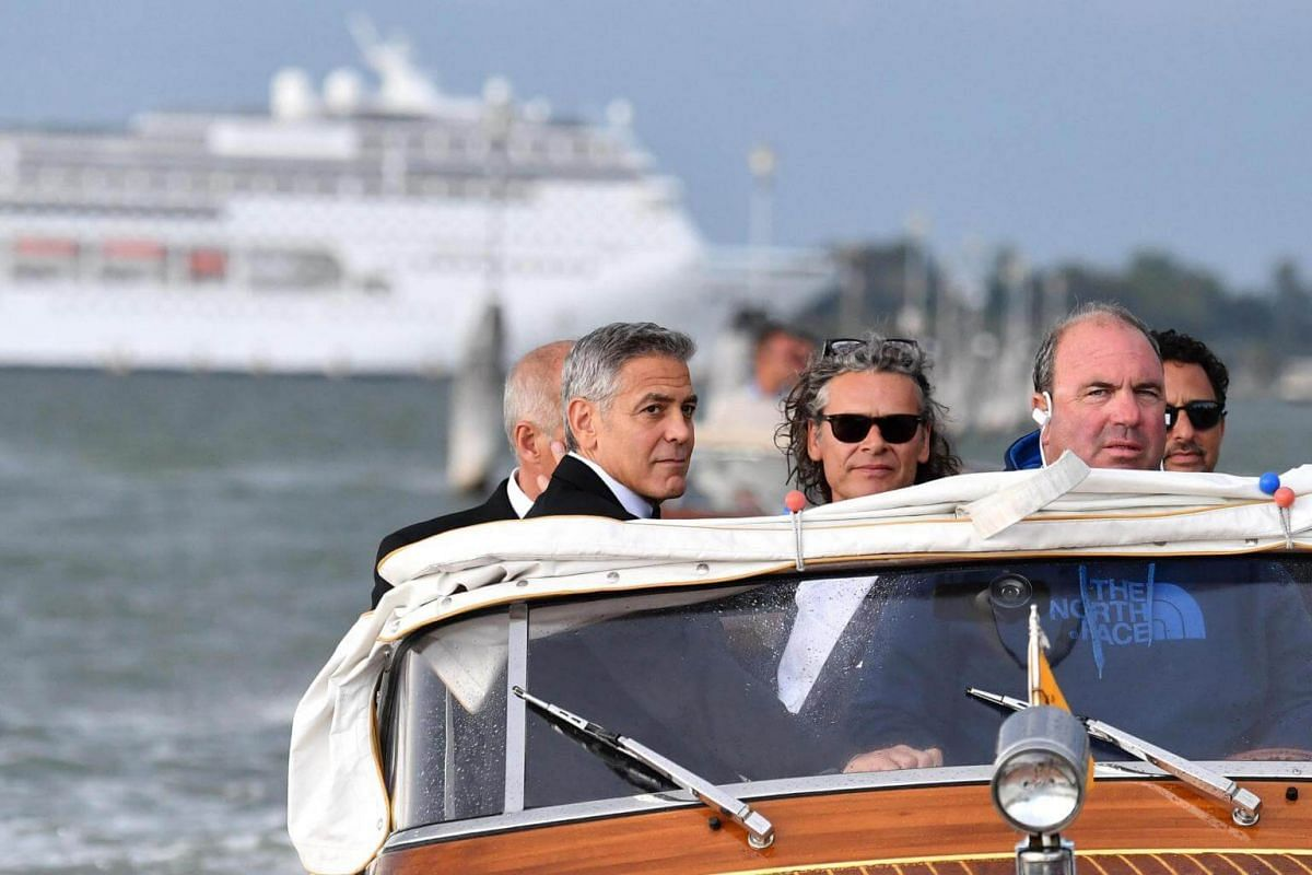 Director George Clooney (left) arriving at the premiere of his movie Suburbicon at the 74th Venice Film Festival on Sept 2, 2017.