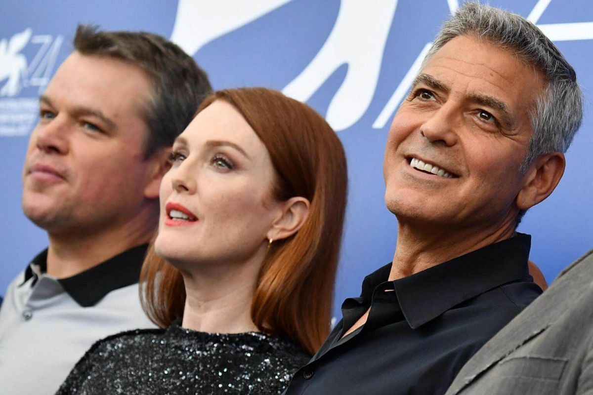 (From left) Matt Damon, Julianne Moore and George Clooney posing during a photocall for Suburbicon at the 74th Venice Film Festival.