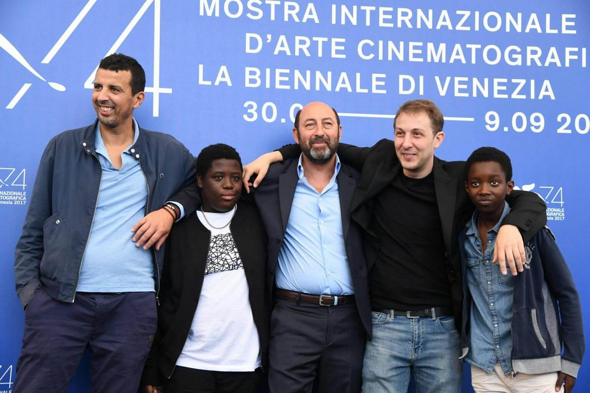 (From left) Actors Samir Guesmi, Youssouf Gueye, Klad Merad, director Rachid Hami and actor Renely Alfred posing during a photocall for La Melodie, on Sept 2, 2017.