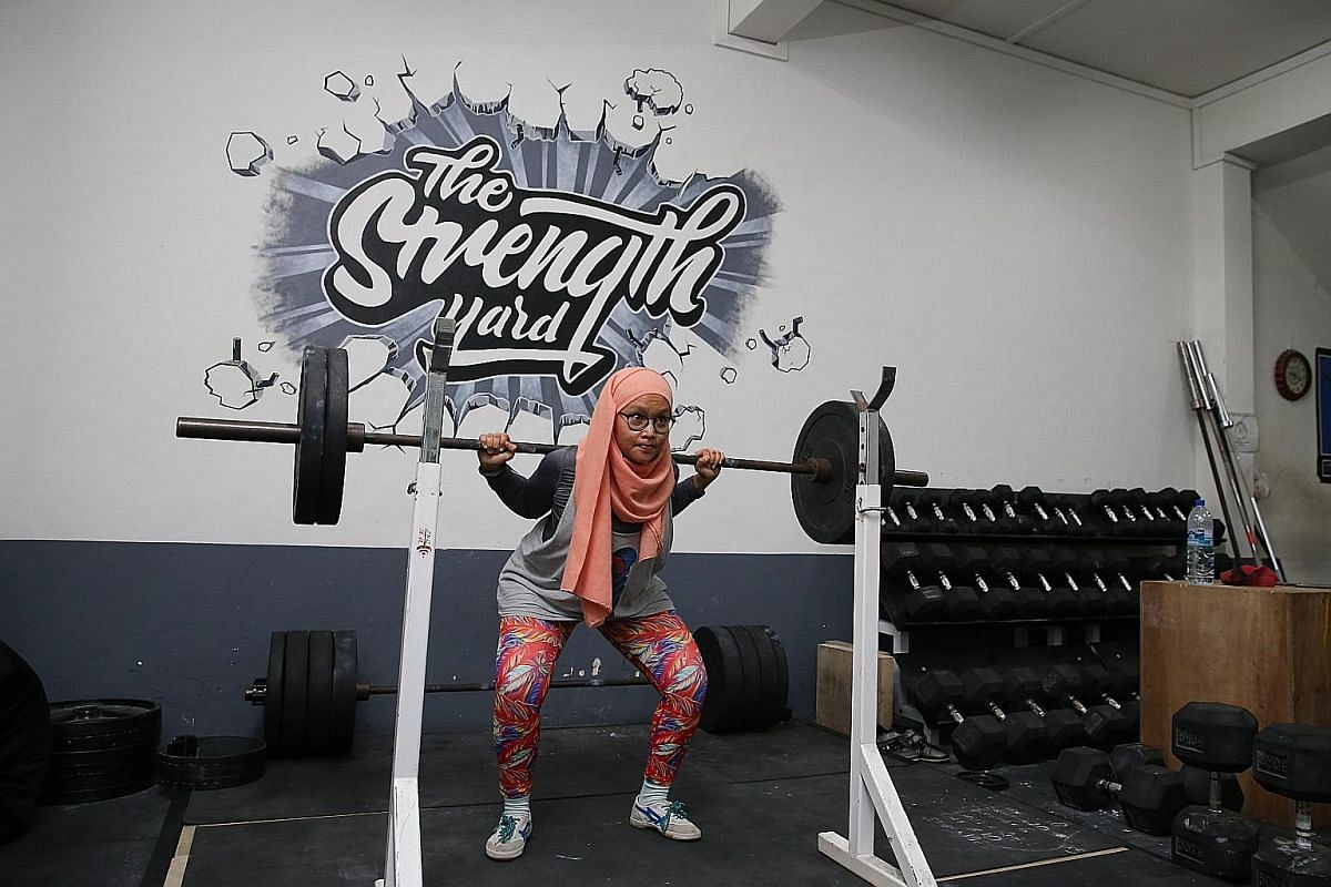 Mr Jasper Wong took part in his first competition last August. Ms Nurul Huda Izyan has taken part in two competitive meets wearing a hijab. Ms Melissa Ong and her mother, Madam Minnie Lee, share a passion for lifting weights.