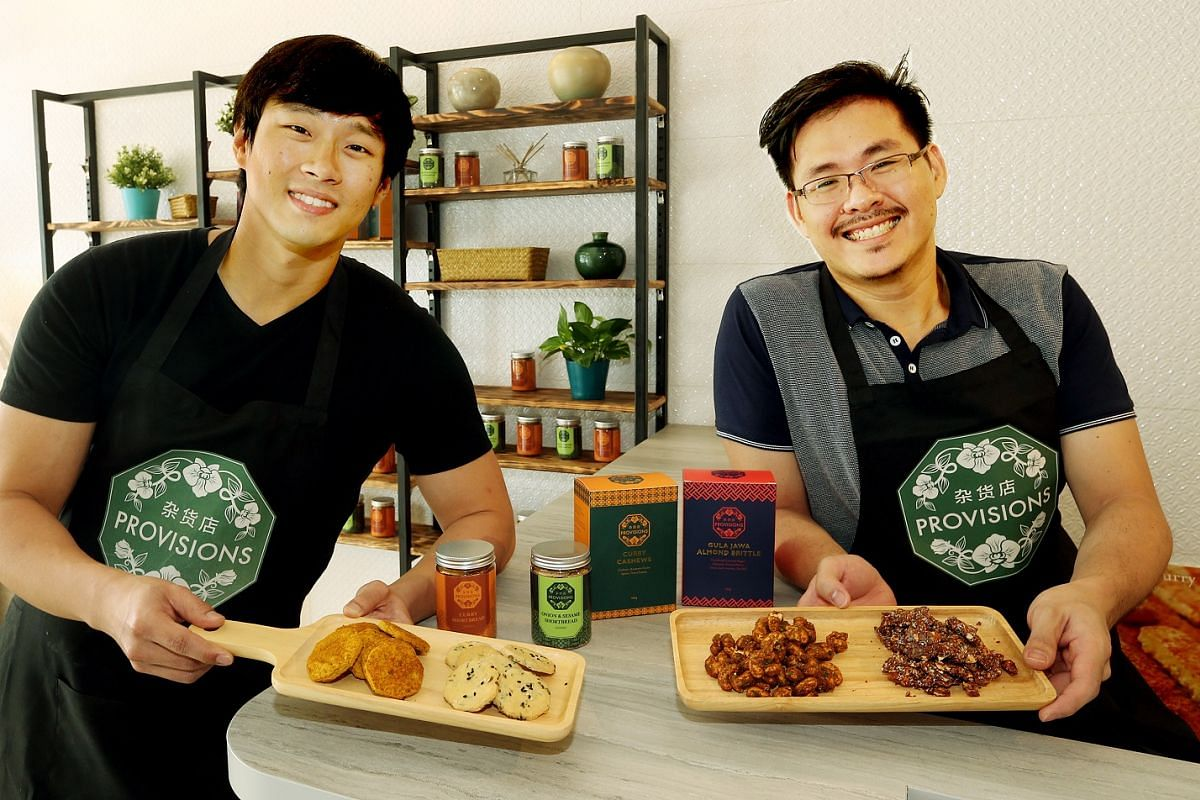 Co-owners of Provisions Paul Ng (left) and Nicholas Tan with a selection of items available at the shop.