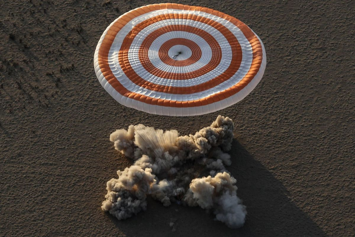A Russian Soyuz MS-04 space capsule carrying Astronauts Peggy Whitson, Jack Fischer of NASA and Fyodor Yurchikhin of the Russian space agency Roscosmos, lands in a remote area outside the town of Zhezkazgan, Kazakhstan, September 3, 2017. PHOTO: EPA
