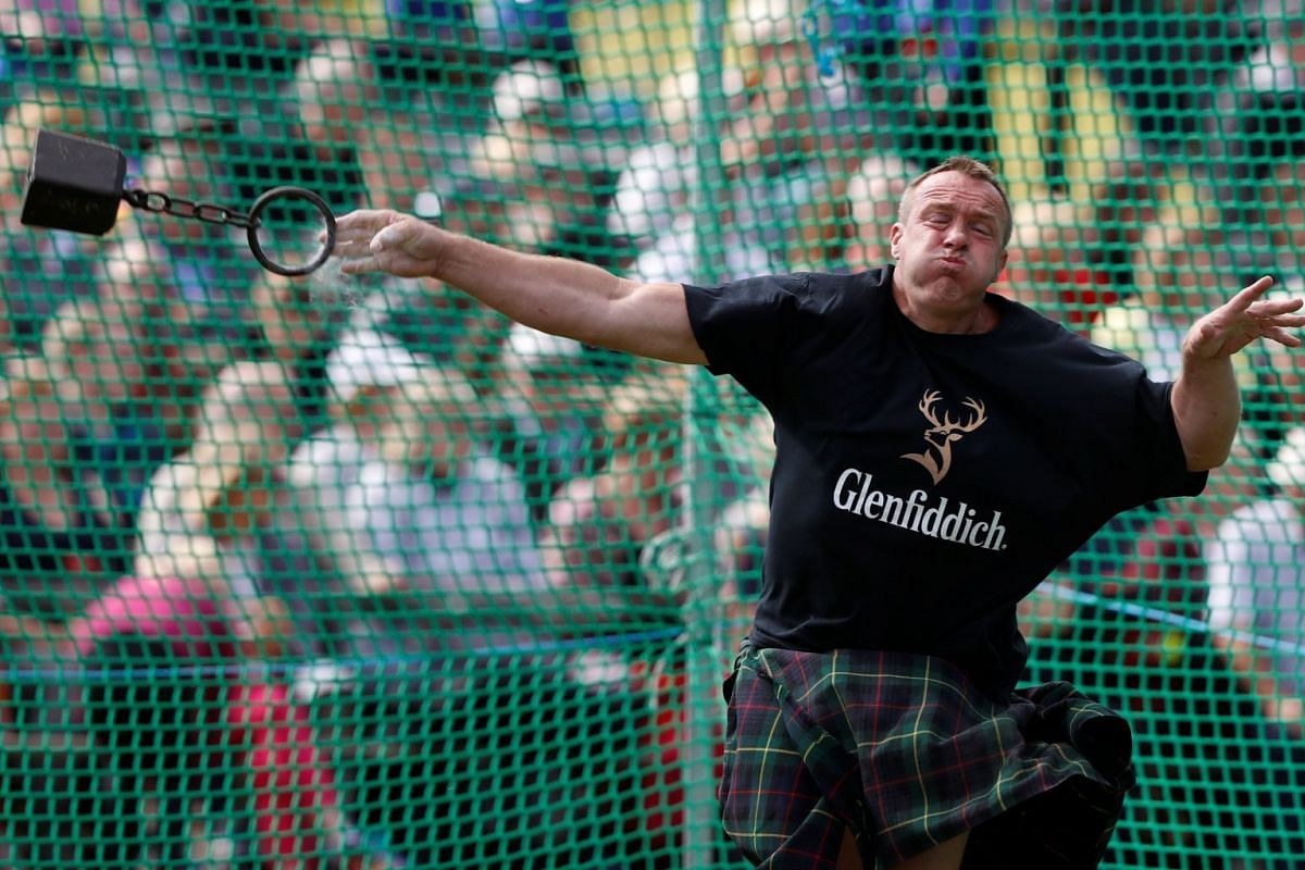 A competitor throws a weight as he participates at the Braemar Highland Gathering in Braemar, Scotland, Britain September 2, 2017. PHOTO: REUTERS