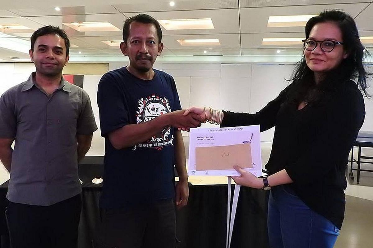 My life so far: Shivaji Das (left) with Malaysian writer Bernice Chauly and Indonesian migrant worker Figo Kurniawan, who came in second at last year's Malaysian edition of the Migrant Worker Poetry Competition.
