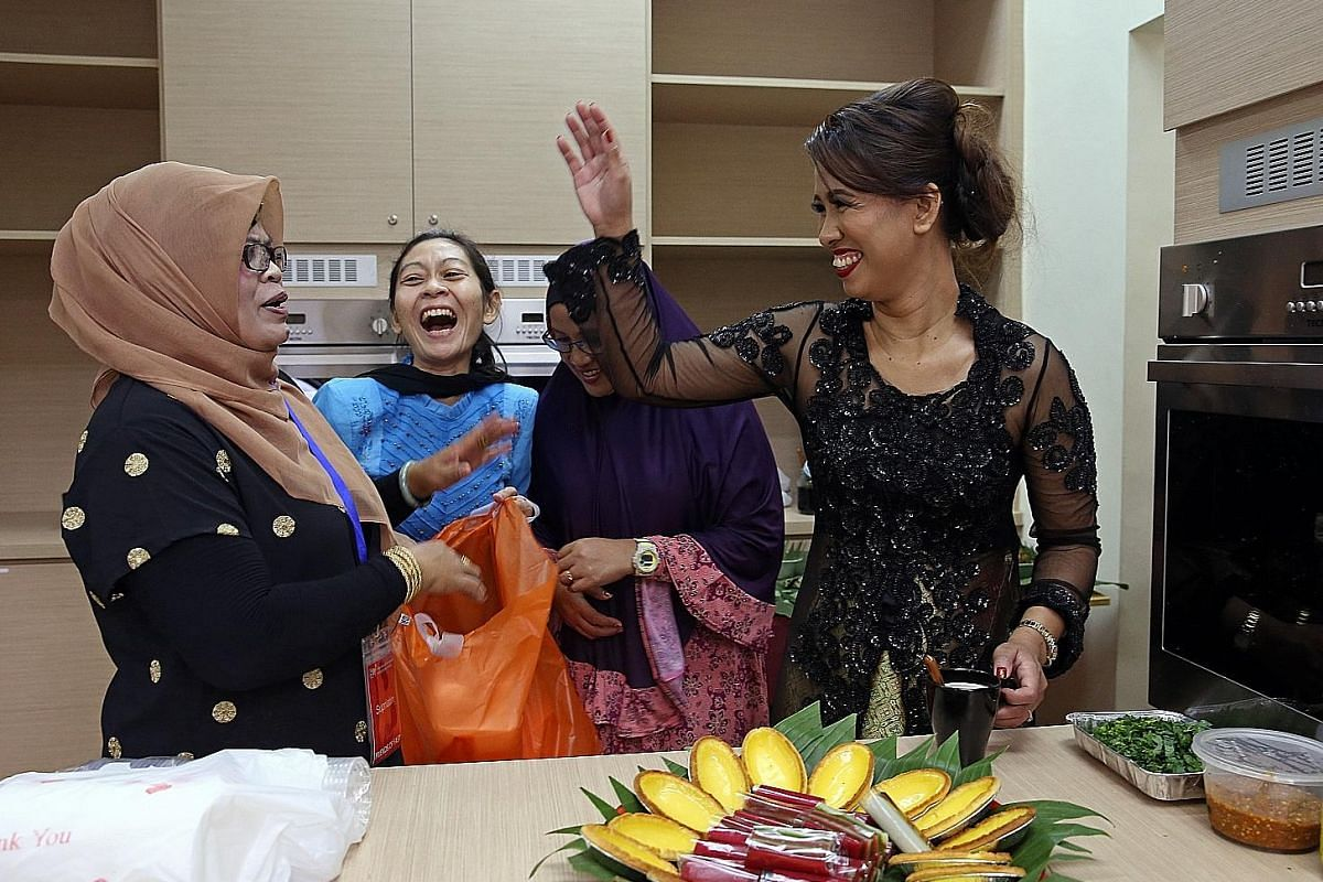 Indonesian Supriyatin (wearing a tudung), 45, and Ms Ifurung (in black), a Filipina, sharing a joke. Both are key members of the clubhouse volunteer group. Ms Supriyatin, a mother figure to the Indonesian foreign domestic workers, is available round the c