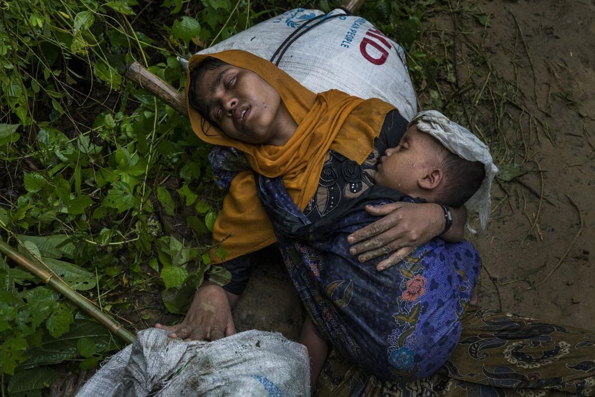 Rohingya refugee Shamsu Nahar collapses with exhaustion and chest pains after crossing the border illegally near Amtoli, on Aug 31, 2017.