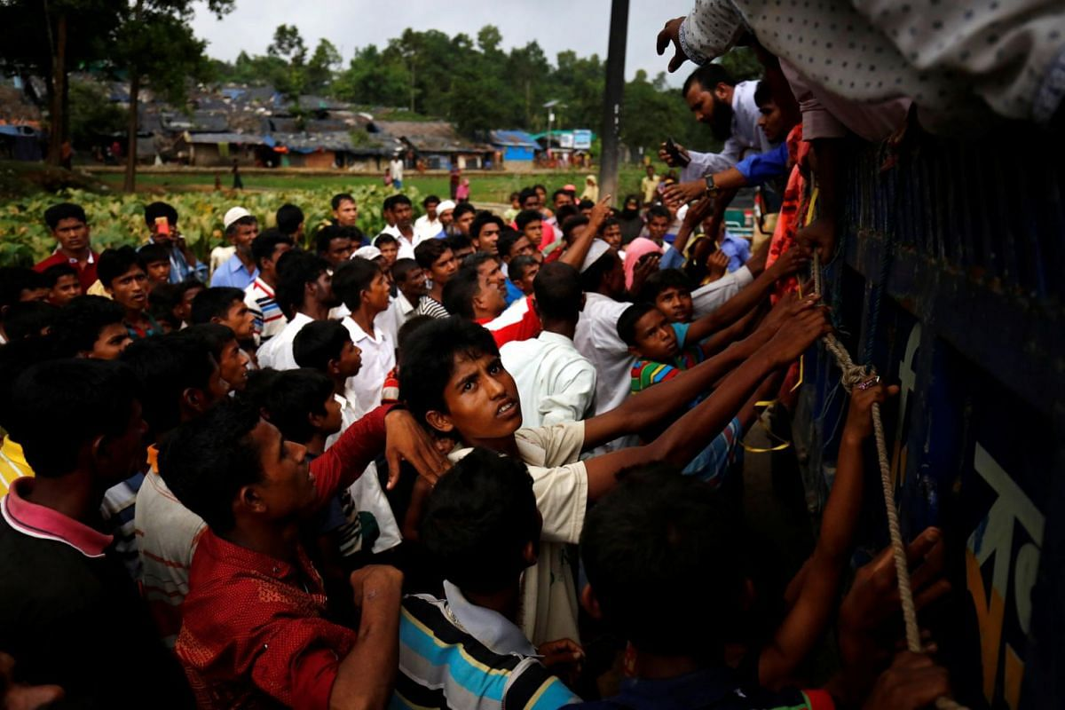 Rohingya refugees gather as they expect relief supplies in Kutupalang near Cox's Bazar, on Sept 3, 2017.