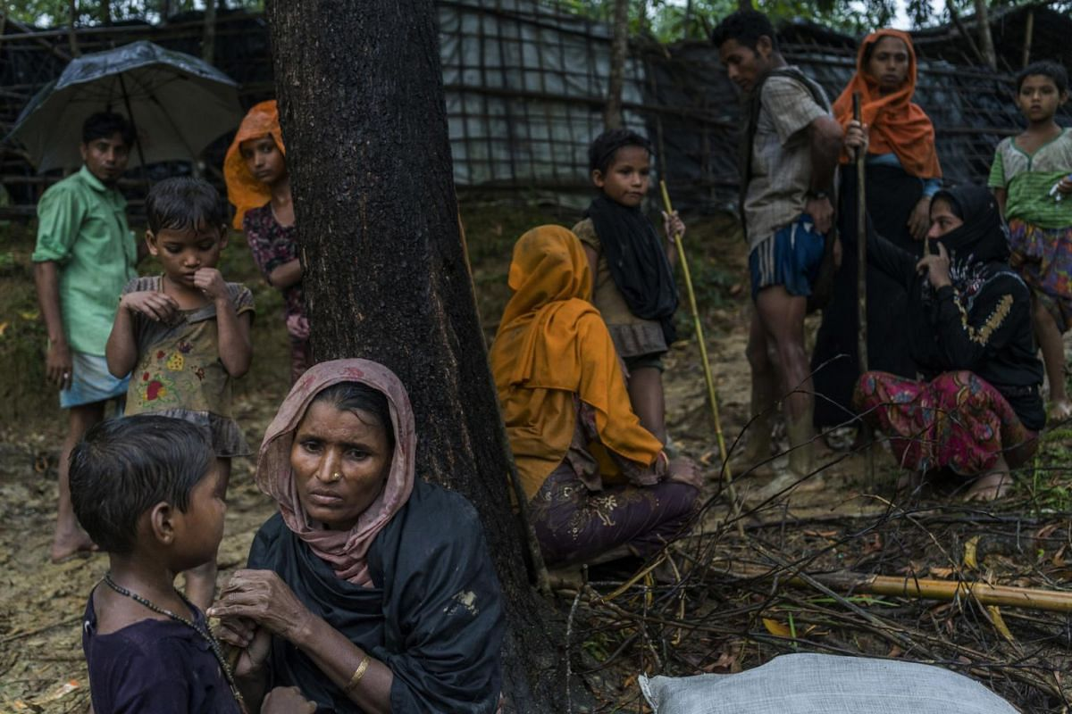Rohingya refugees from Myanmar resting near a refugee camp after crossing the border illegally near Amtoli, on Aug 31, 2017.