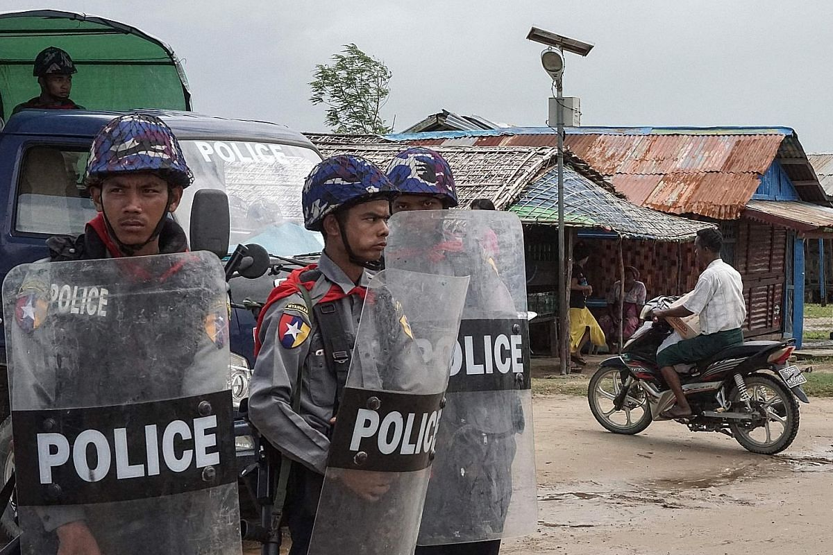 Myanmar police at an Internally Displaced Persons camp in Sittwe, Rakhine, last Friday. UN chief Antonio Guterres has urged security forces to show restraint after hundreds were reported killed in communal violence.