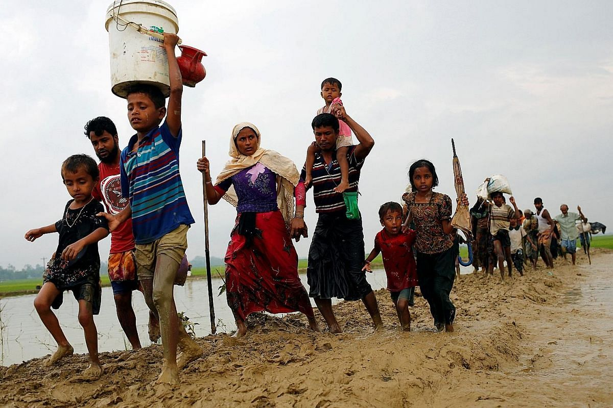 Rohingya refugees after crossing the Myanmar border into Bangladesh on Sunday. Rights monitors and the Rohingya say the Myanmar army is trying to force Rohingya out with a campaign of arson and killings.