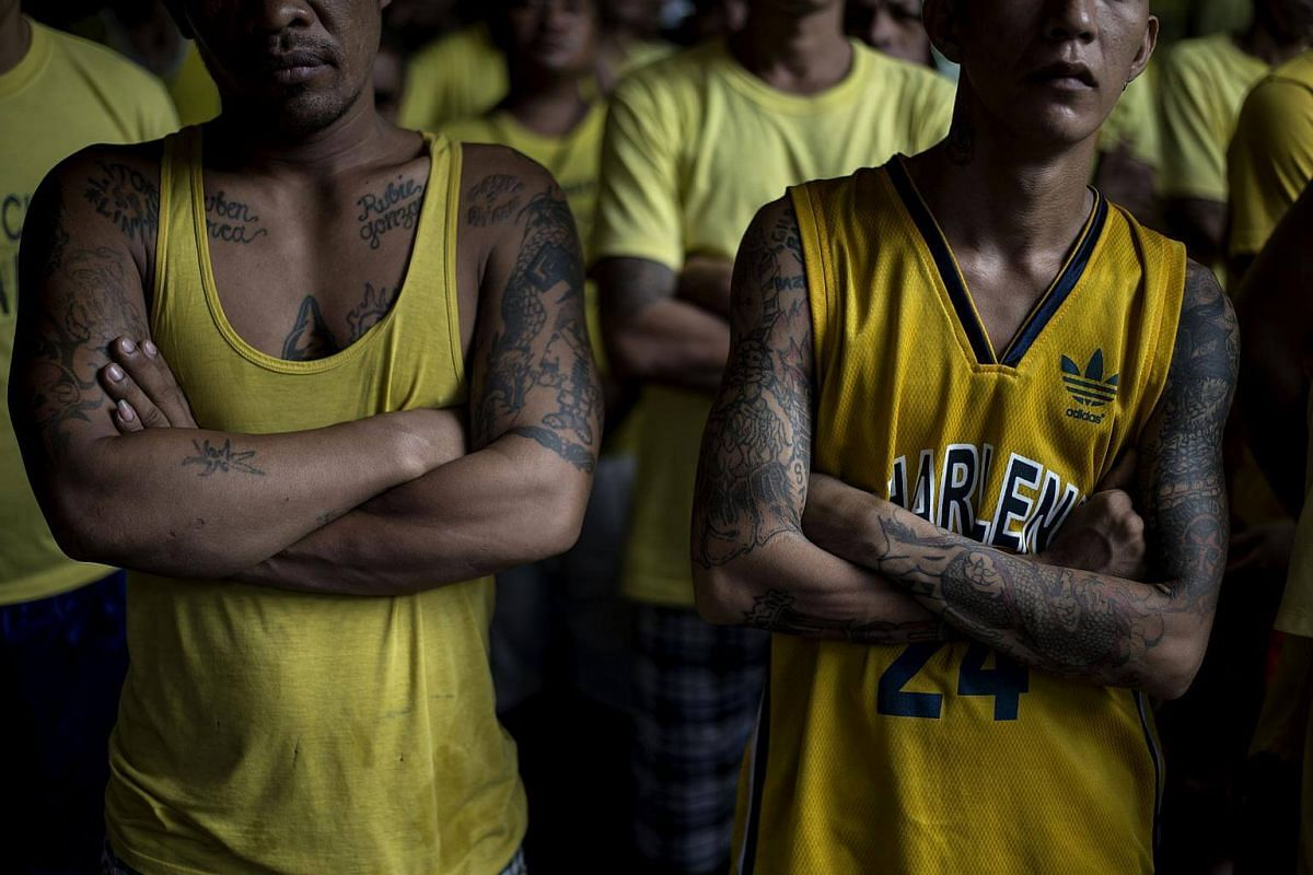 Inmates during a flag raising ceremony inside the Quezon City Jail in Manila, on July 11, 2017.
