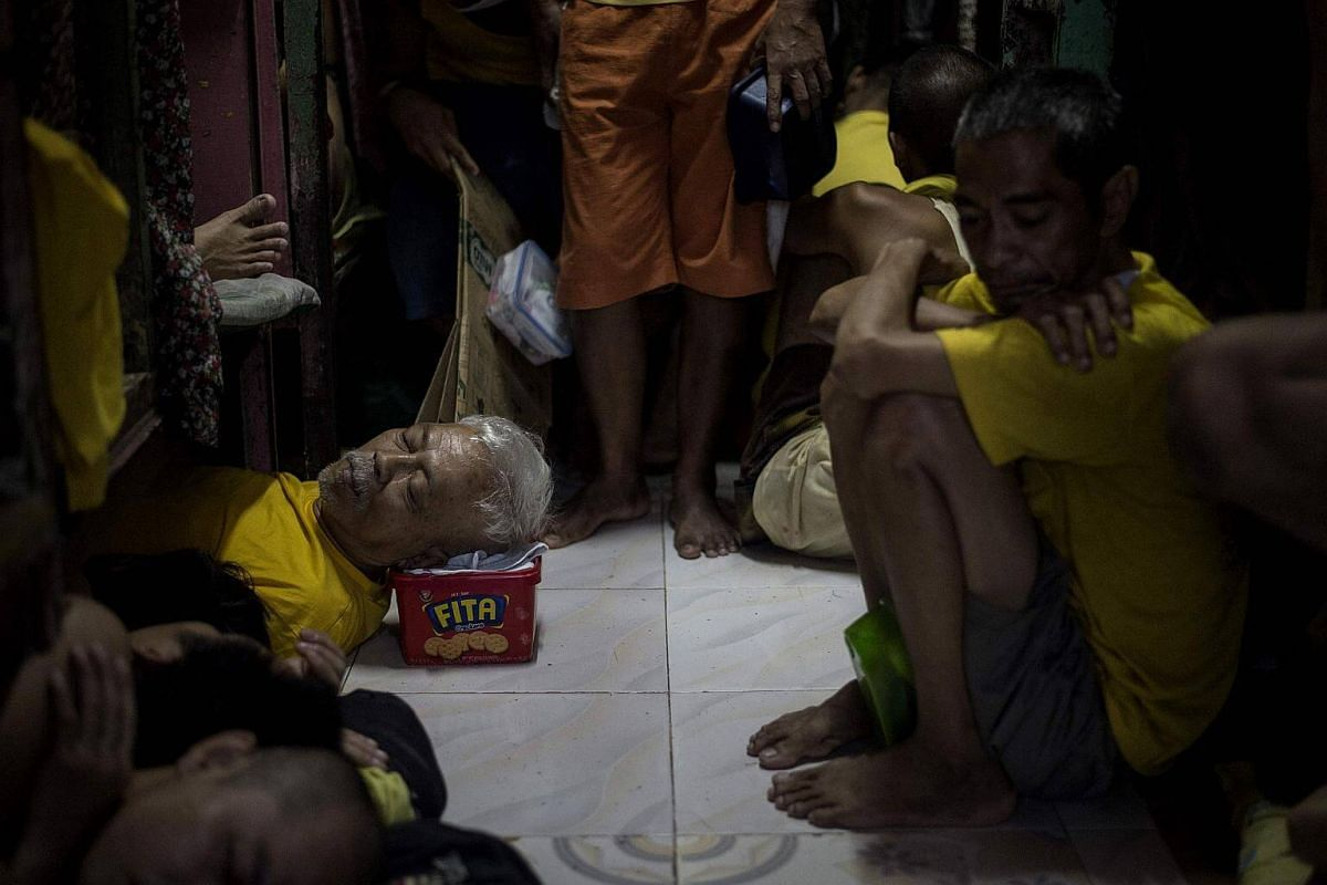 Inmates sleeping inside the Quezon City Jail in Manila on July 27, 2017.