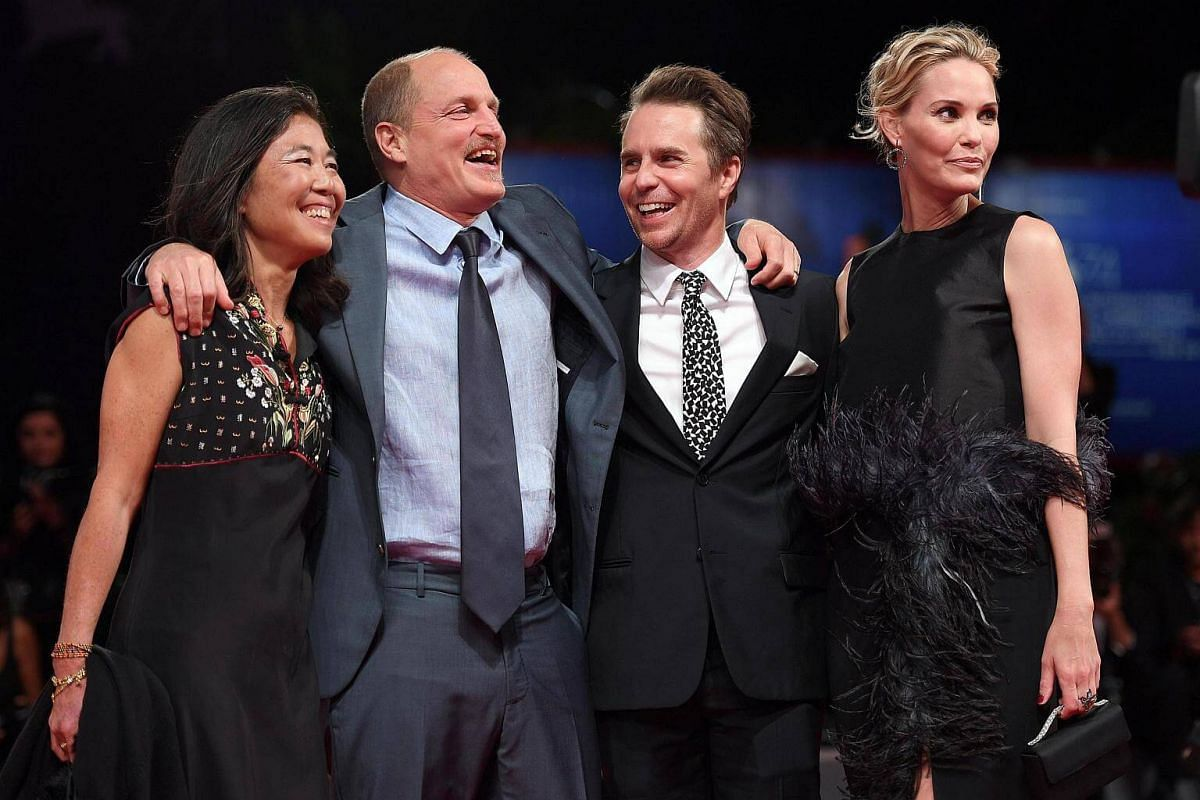 Arriving for the premiere of Three Billboards Outside Ebbing, Missouri are (from left) Laura Louie, wife of American actor cast member Woody Harrelson, fellow cast member Sam Rockwell and his partner Leslie Bibb at the 74th Venice Film Festival, in I