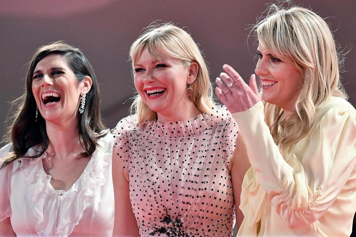 Fashion designers, directors and sisters, Kate (right) and Laura Mulleavy (left) with actress and cast member Kirsten Dunst (centre) arrive for the premiere of Woodshock during the 74th Venice Film Festival, in Italy, on Sept 4, 2017.