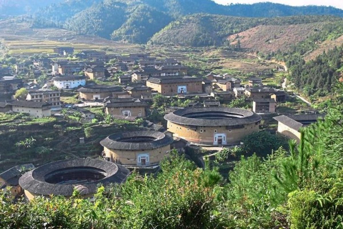The Chuxi Tulou cluster in Xiayang, Yongding, comprises 36 conserved tulou.