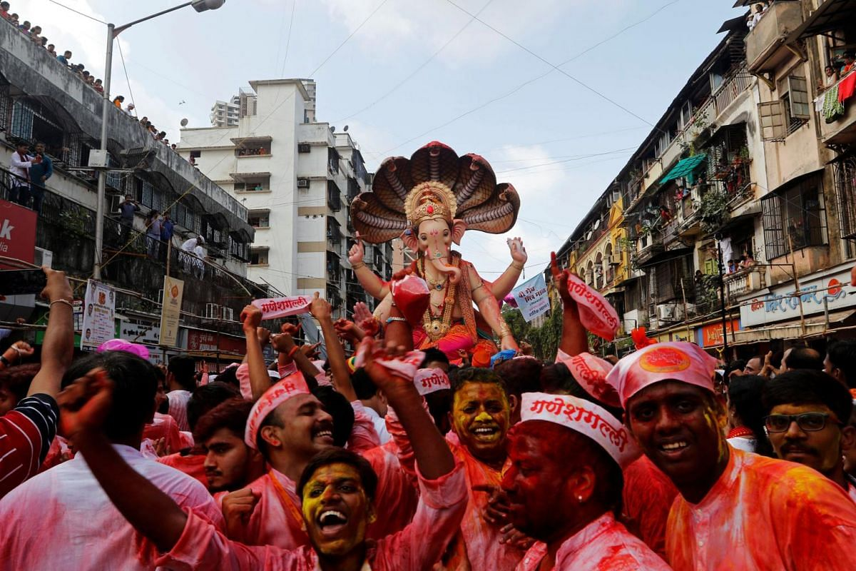 Devotees dance as they carry the idol of the Hindu god Ganesh, the deity of prosperity, during a procession on the last day of the Ganesh Chaturthi festival, in Mumbai, India on Sept 5, 2017.