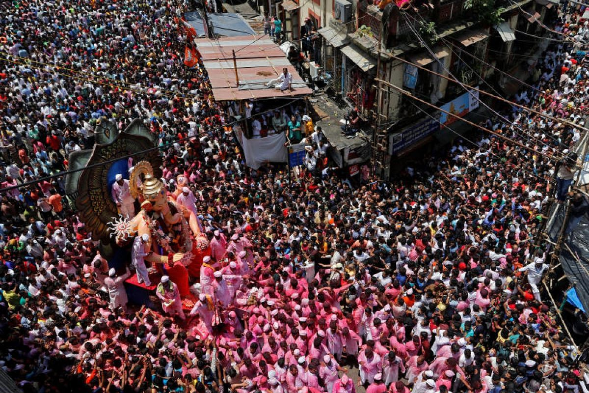 Devotees carry the idol of Hindu god Ganesh during a procession on the last day of the Ganesh Chaturthi festival, before immersing the idol into the Arabian sea, in Mumbai, India on Sept 5, 2017.