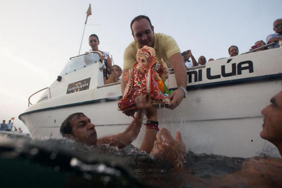 Devotees carry an idol of the Hindu god Ganesh before immersing it into the Mediterranean sea during Ganesh Chaturthi festival in Ceuta, Spain, on Aug 27, 2017.