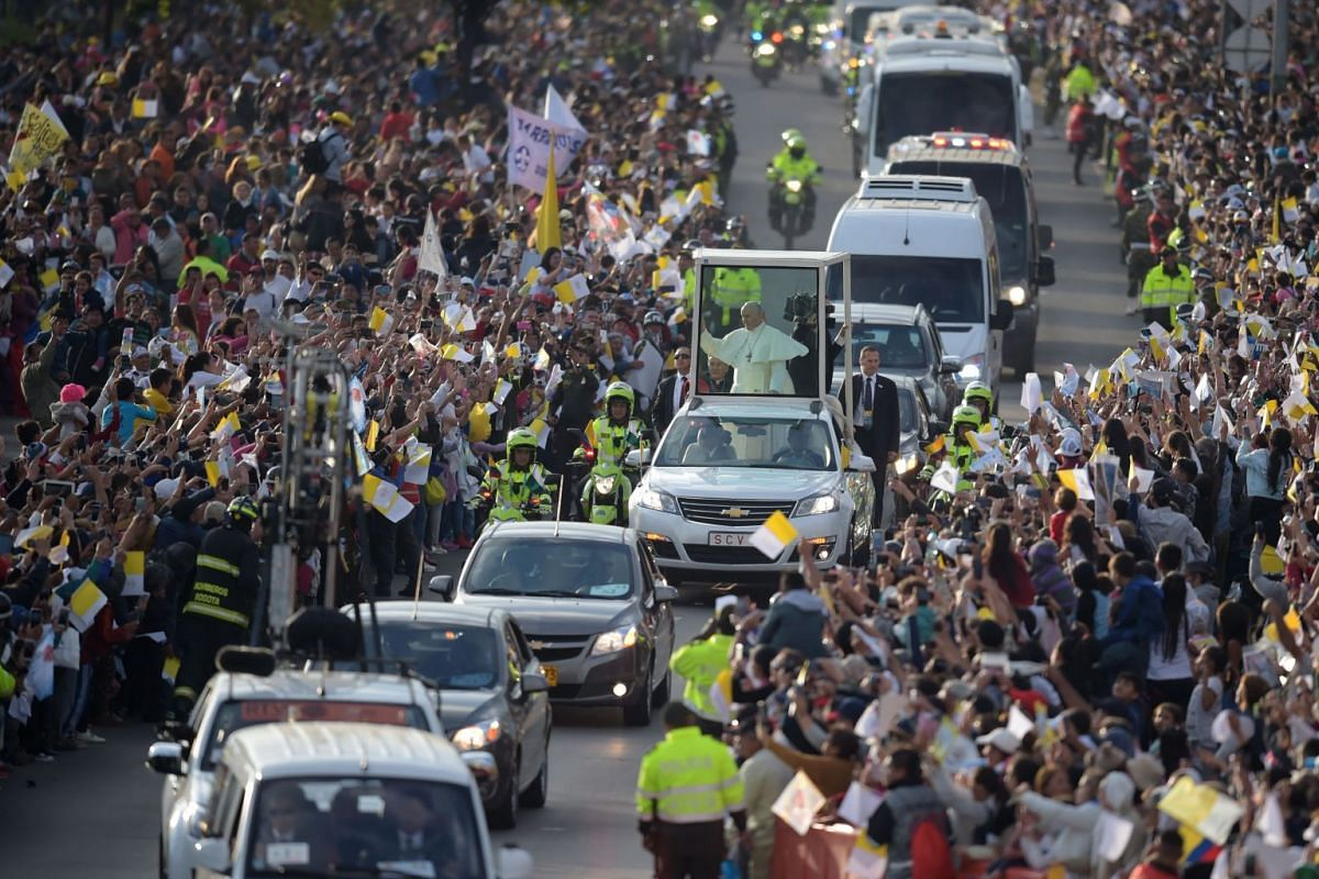 Pope Francis waves from the Popemobile upon arrival in Bogota, Colombia on September 6, 2017. PHOTO: AFP