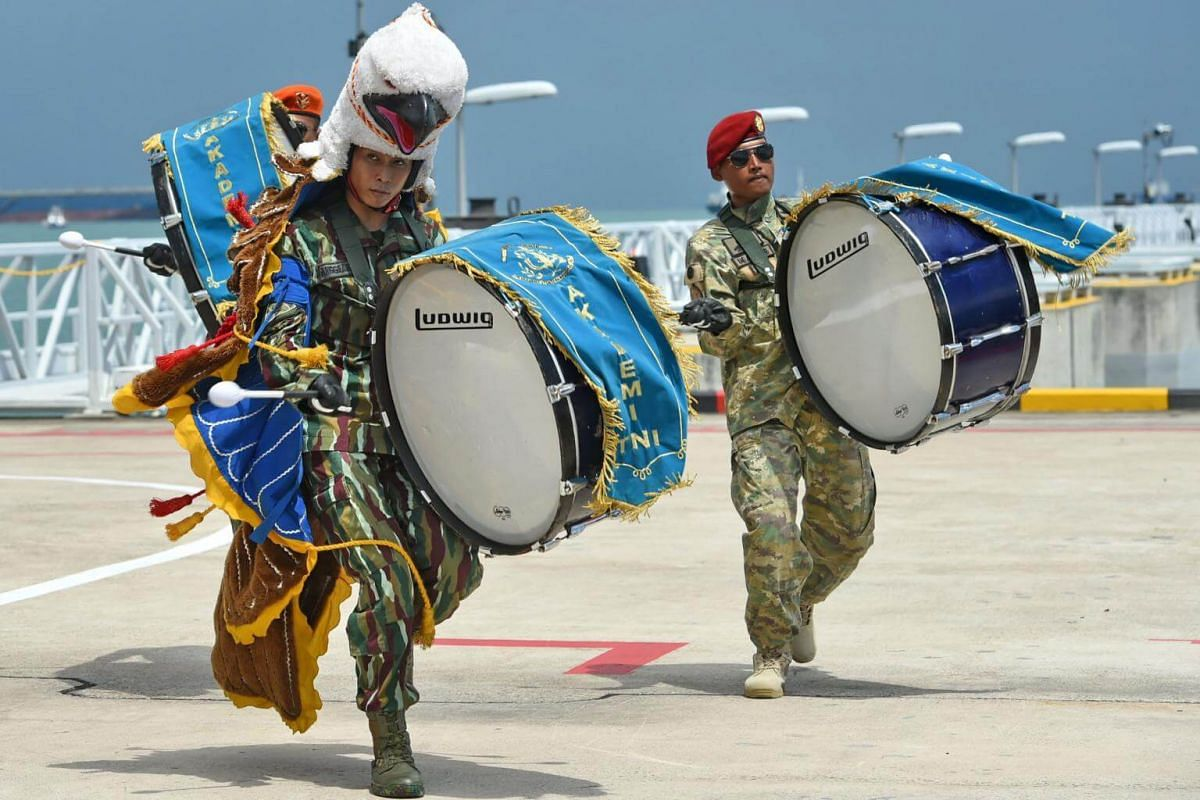 Indonesia military band personnel perform during the Republic of Singapore Air Force F16s and Indonesian Air Force TNI-AU F16s aerial flypast at the Marina Bay Cruise Centre in Singapore on Sept 7, 2017.