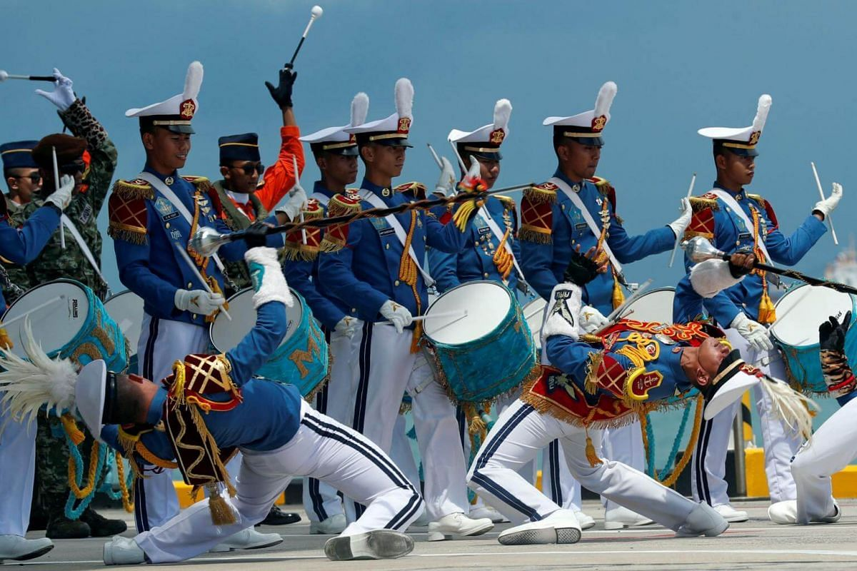 An Indonesian military band performs for Indonesia's President Joko Widodo and Singapore's Prime Minister Lee Hsien Loong, to mark 50 years of bilateral relations between the two countries, at the Marina Bay Cruise Centre in Singapore on Sept 7, 2017
