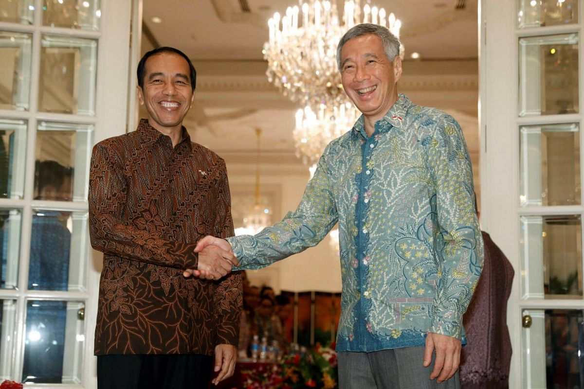 Indonesia's President Joko Widodo shakes hands with Singapore's Prime Minister Lee Hsien Loong at the Istana in Singapore on Sept 7, 2017.
