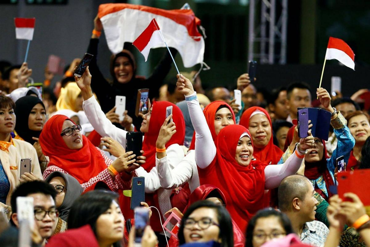 People wait for the arrival of Indonesia's President Joko Widodo at the Indonesian embassy in Singapore September 6, 2017.