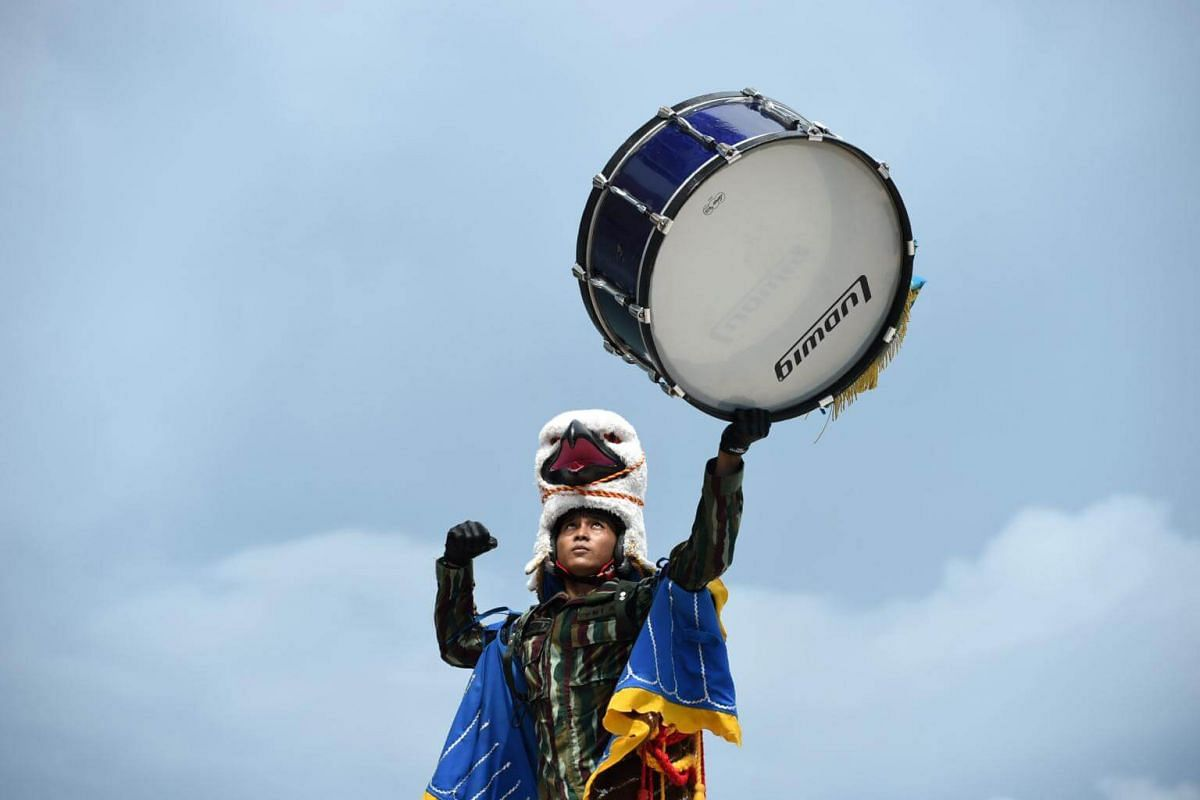 An Indonesian military band personnel performs during the Republic of Singapore Air Force F16s and Indonesian Air Force TNI-AU F16s aerial flypast at the Marina Bay Cruise Centre in Singapore on Sept 7, 2017.