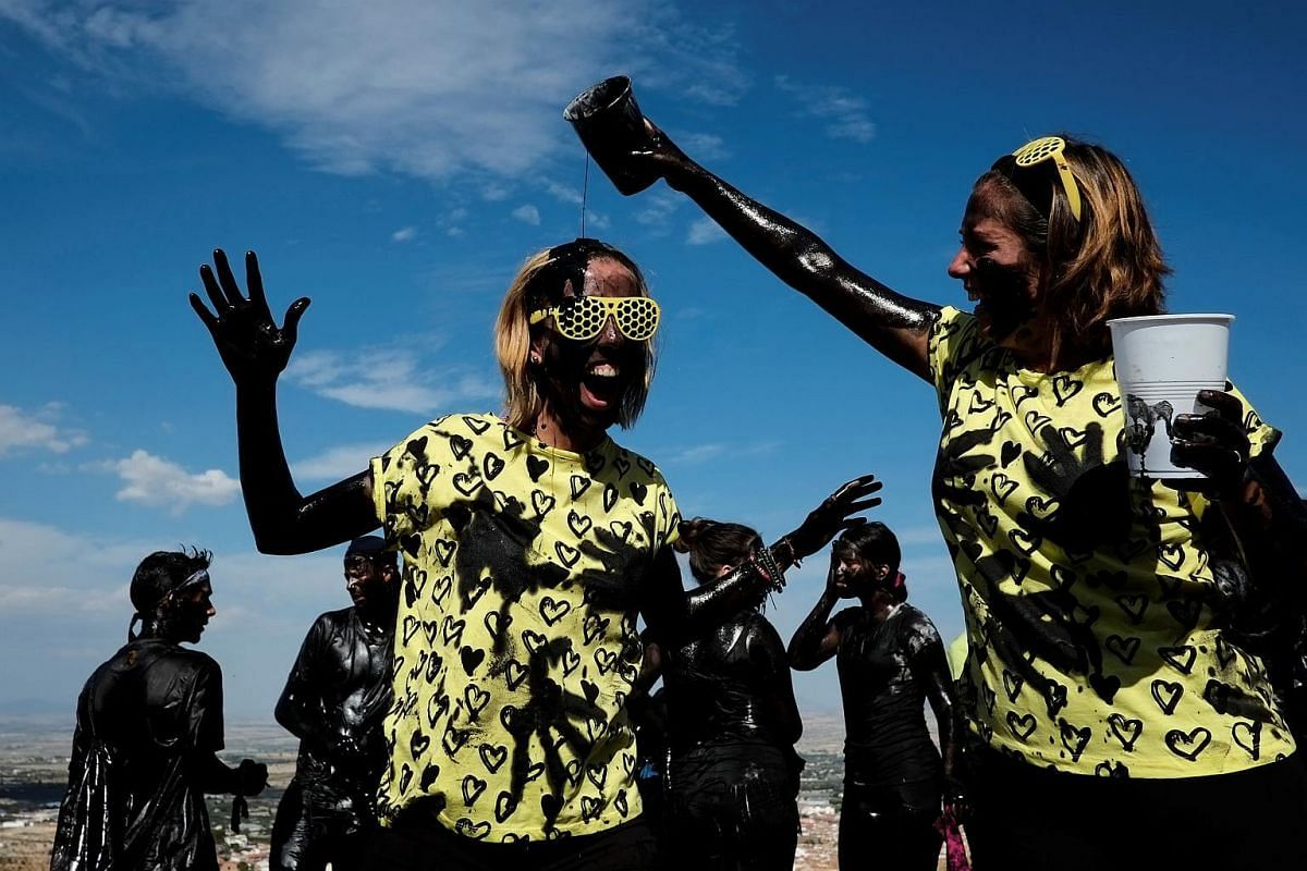 Revellers put grease on their bodies as they take part in the annual Cascamorras festival in Baza, Spain on Sept 6, 2017.