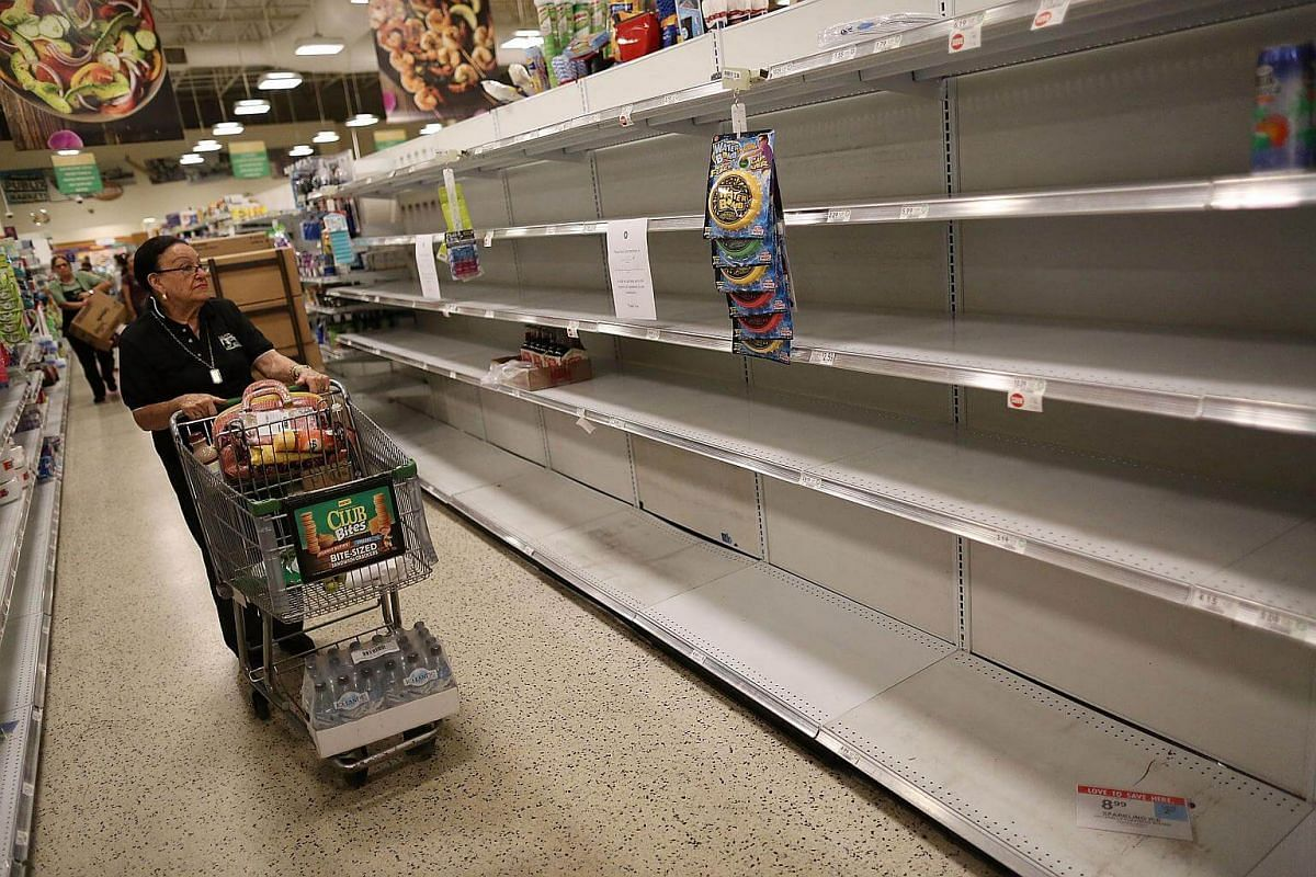 Bare shelves are seen after the supply of bottled water was emptied at a grocery store by people preparing for Hurricane Irma in Miami, Florida on Sept 6, 2017.