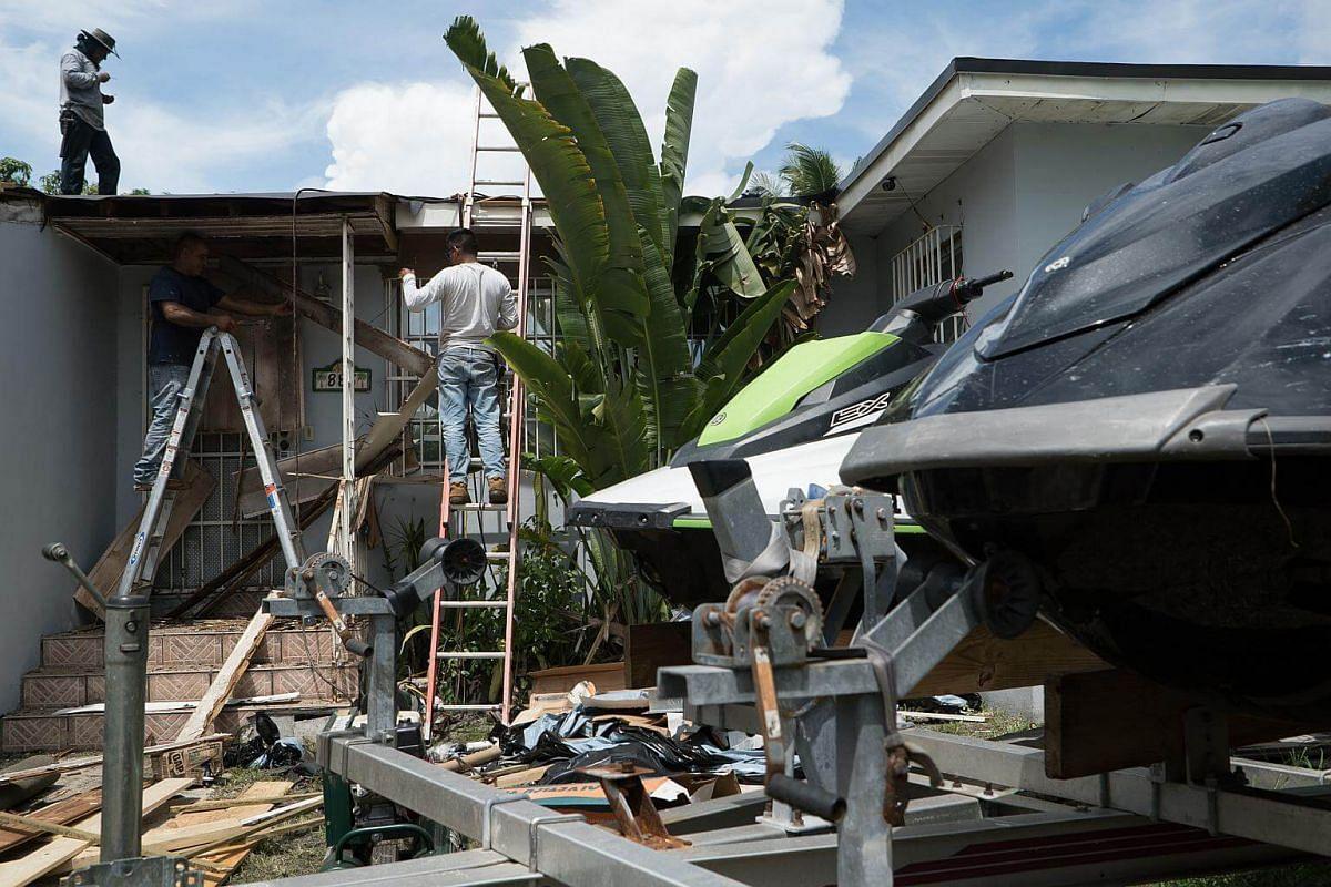 Contractors prepare a home ahead of Hurricane Irma in Miami, on Sept 6, 2017.