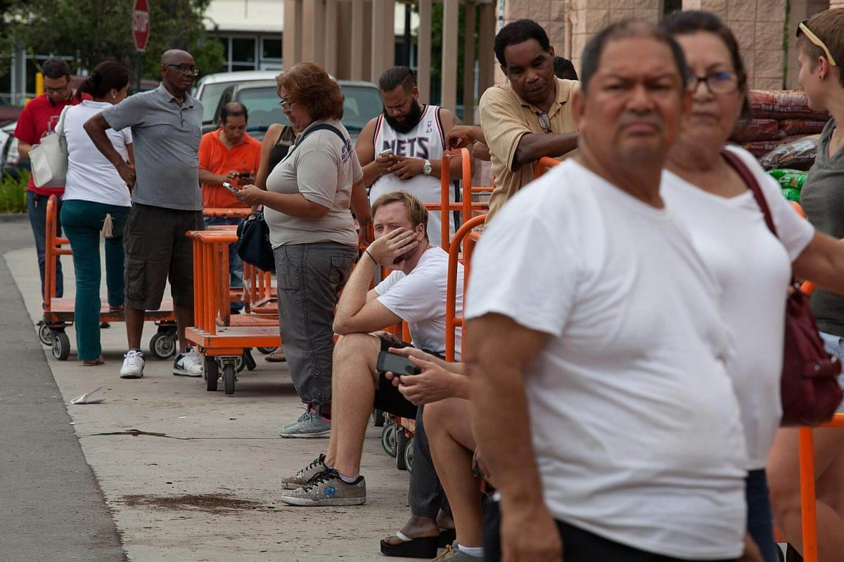 Residents wait in line outside a Home Depot Inc store ahead of Hurricane Irma in Miami, on Sept 6, 2017.