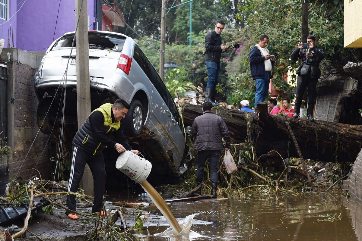 A scene in Mexico City's borough of Xochimilco on September 7, 2017 after heavy rains caused the overflowing of the San Buenaventura river. PHOTO: AFP