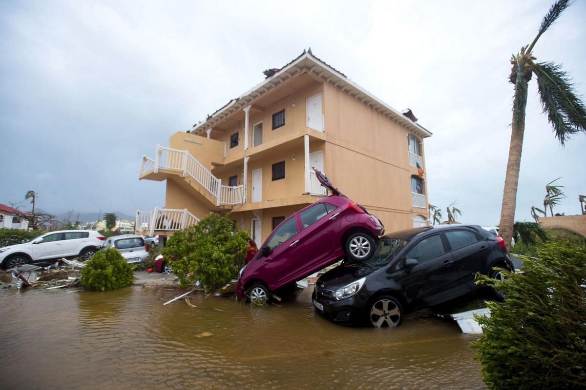 Cars piled on top of one another in Marigot, near the Bay of Nettle, on the French Collectivity of Saint Martin on Sept 6, 2017.