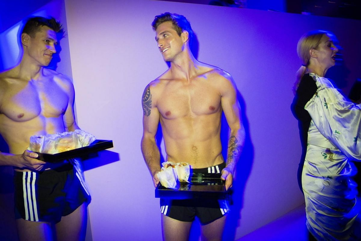 Shirtless waiters passing out hamburgers at the Tom Ford afterparty at the Park Avenue Armory during New York Fashion Week, on Sept 6, 2017.