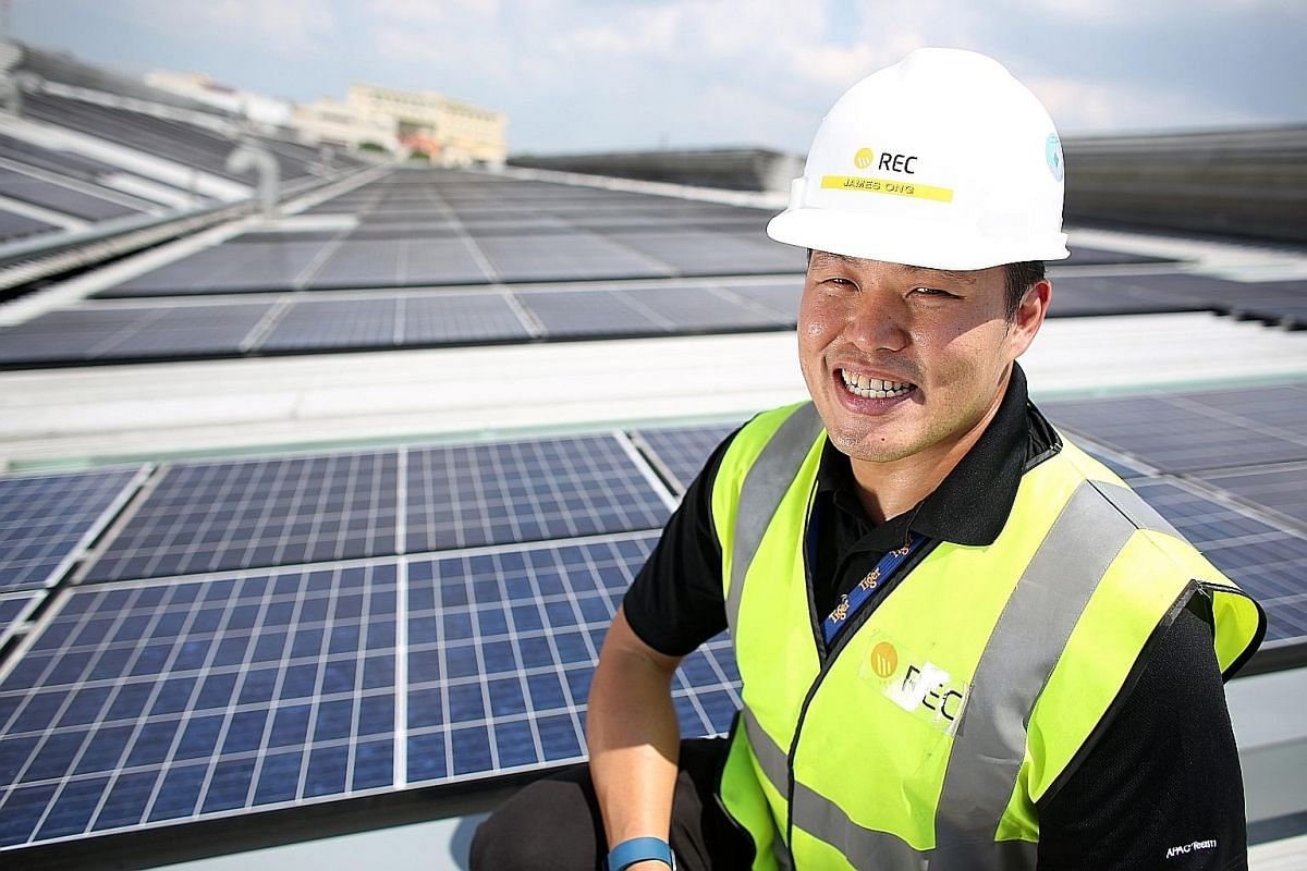 Mr James Ong of REC Solar on the rooftop of Asia Pacific Breweries Singapore's brewery in Jalan Ahmad Ibrahim. The panels were installed by the solar panel manufacturer in 2015.