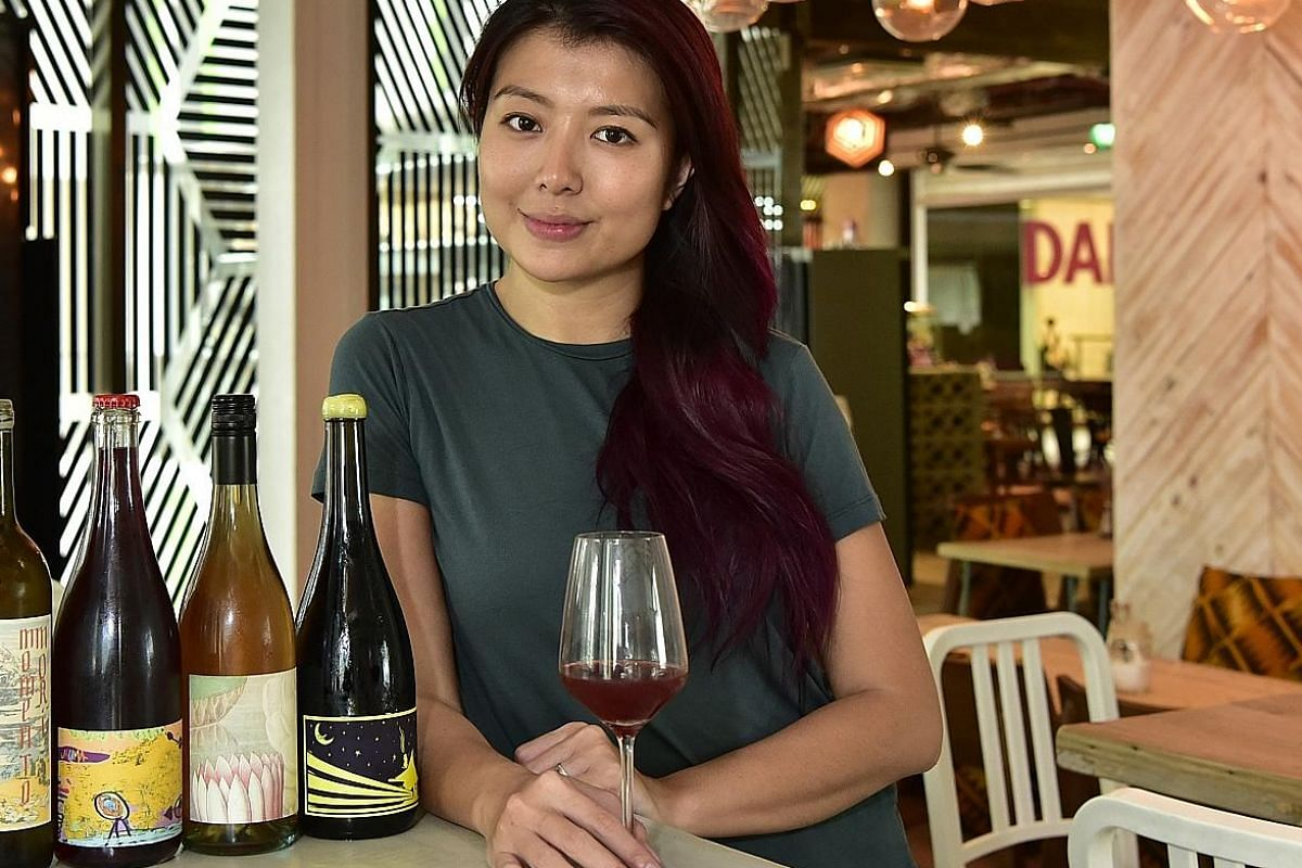 Montana's Ms Huang Shiying. Mr Kasster Soh and Ms Jasmin Wong of Temple Cellars. Mr Ian Lim, co-owner of RVLT, which stocks natural, organic and biodynamic wines. His phone shows a photo of co-owner Alvin Gho.