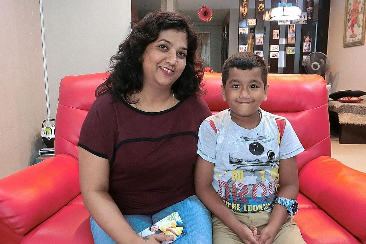 """Ms Mary Rajini sent her son Jordan Justin (both above), eight, for a handwriting improvement class and says his handwriting (left) has improved by """"90 per cent""""."""