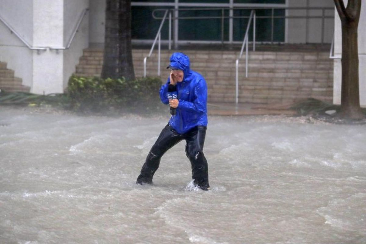 Meteorologist Mike Seidel of the The Weather Channel fights fierce winds and flooded streets while reporting on the full effects of Hurricane Irma's strike in Miami, Florida, on Sept 10, 2017.