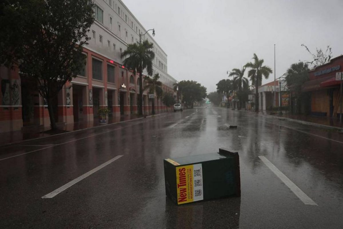 Debris blown around by high winds is seen in the street as hurricane Irma arrives in Miami, Florida, on Sept 10, 2017.