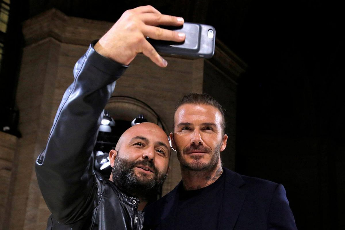 David Beckham poses for a selfie with an attendee as he attends the Victoria Beckham Spring/Summer 2018 collection presentation at New York Fashion Week in Manhattan, on Sept 10, 2017.