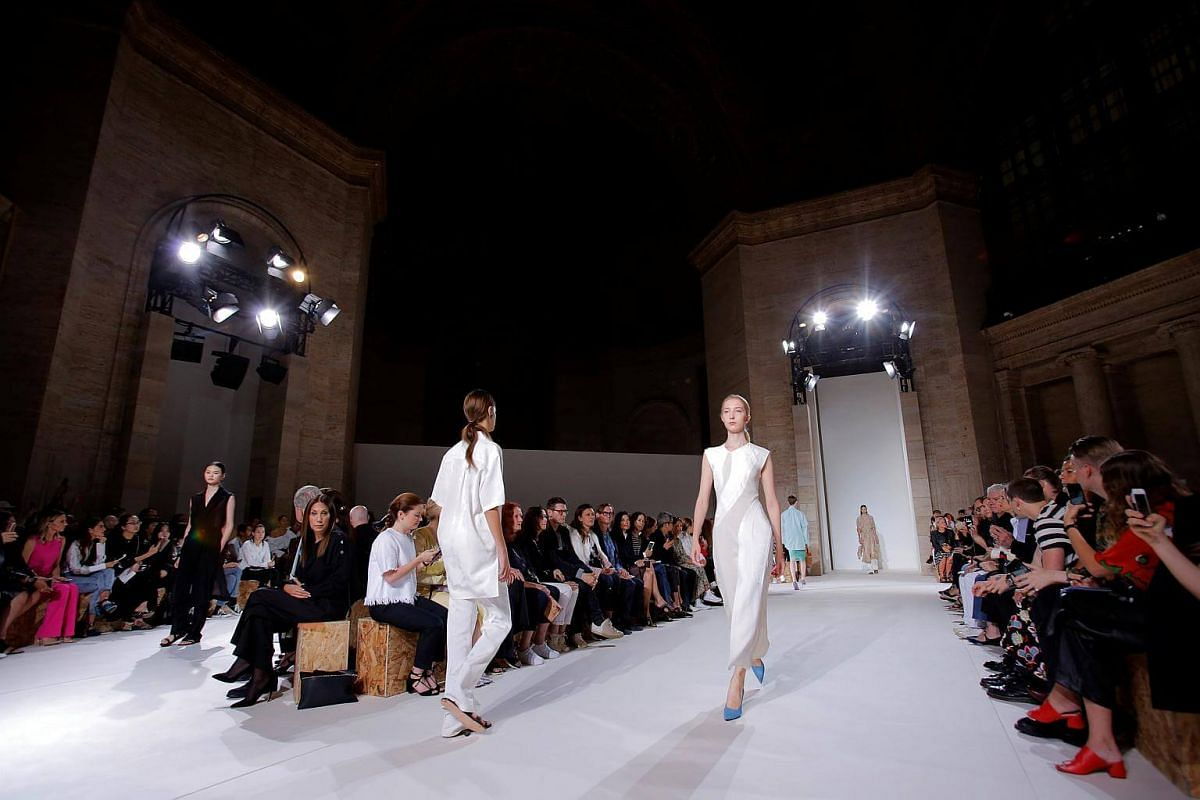 Models present creations from the Victoria Beckham Spring/Summer 2018 collection at New York Fashion Week in Manhattan, on Sept 10, 2017.
