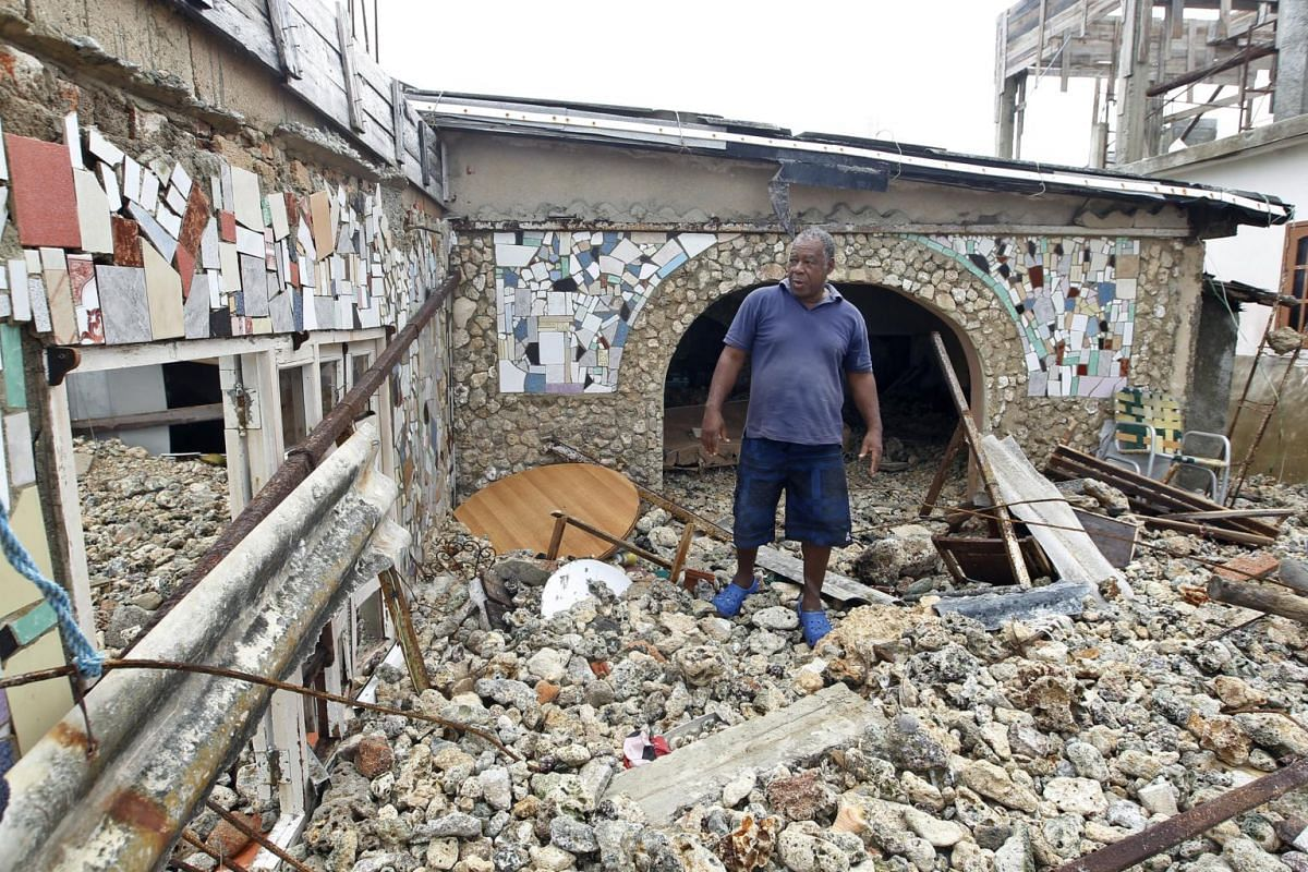 A man observes the damage to his house after the passage of the Irma hurricane in Havana, Cuba, on Sept 10, 2017.